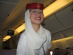identify the name of the airlines from the picture of the air hostess in unifrom