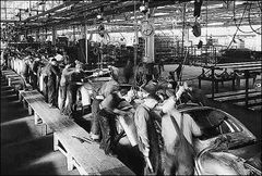 Who invented moving assembly line and brand franchise concept in automobile industry?