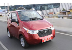 Which Indian automobile maker entered into Bhutan Market with the launching of electric car e20?